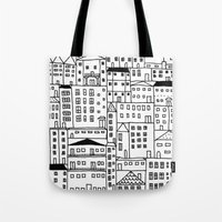 cityscape Tote Bags featuring cityscape by Anna Grunduls