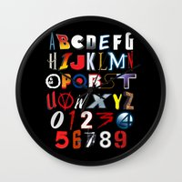 movies Wall Clocks featuring 'M' is for 'Movies' by Andrew Treherne