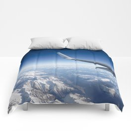 Flying over the Alps Comforters