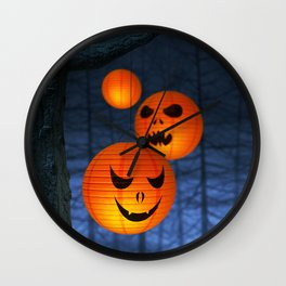 Halloween paper lanterns in a dark and spooky forest Wall Clock