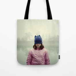 Sad girl with eyes covered by cap. Tote Bag