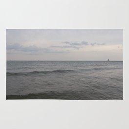 Distant Lighthouse on Lake Michigan Rug