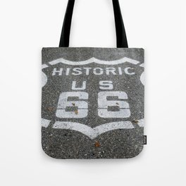 Route 66 sign on the road Tote Bag