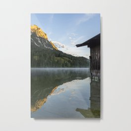 Misty Lake Portrait with boathouse. Amazing shot of a wooden house in the Ferchensee lake in Bavaria, Germany, in front of a mountain belonging to the Alps. Scenic foggy morning scenery at sunrise. Metal Print