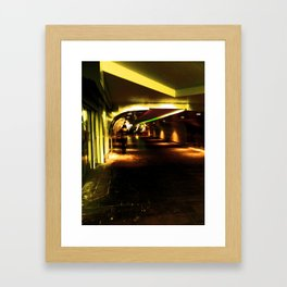 Woman in subway station Framed Art Print