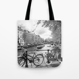 Bicycles parked on bridge over Amsterdam canal Tote Bag