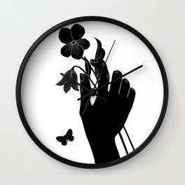 Black Hand Holding Flowers Wall Clock