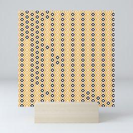 orange and black rhombuses Mini Art Print