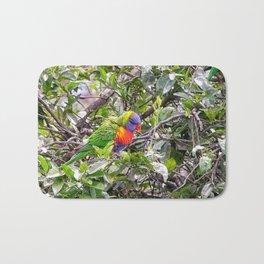 Rainbow lorikeet in tree Bath Mat