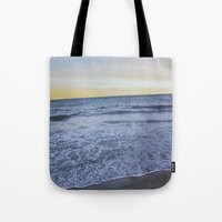 rileigh smirl Tote Bags featuring Ocean Sunset by Rileigh Smirl