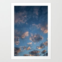 Blue sky with isolated clouds during sunset. Art Print