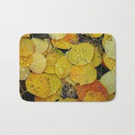 Water droplets on autumn aspen leaves Bath Mat