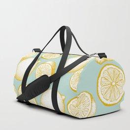 Lemons On Turquoise Background Duffle Bag