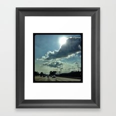 Admiring the clouds. Framed Art Print