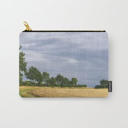 Rainclouds over treelined stubbled field. Norfolk, UK. Carry-All Pouch
