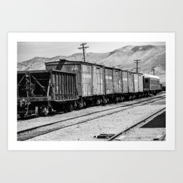 Vintage train cars in rail yard in Black & White Art Print