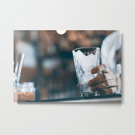 Bartender prepares a cocktail in the nightclub. Expert barman is making cocktail at night club. Metal Print