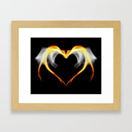 Fire heart with wings Framed Art Print