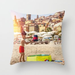 Young boy playing on a beach in French Riviera Throw Pillow