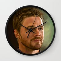 stephen king Wall Clocks featuring Stephen Amell by Chanuka Hemachandra