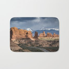 Storms over the La Sal Mountains and Turret Arch in Arches National Park, Utah Bath Mat