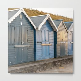 Traditional wooden beach huts on the North Norfolk coastline Metal Print