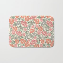 Orange poppies and red roses with keys on light background Bath Mat