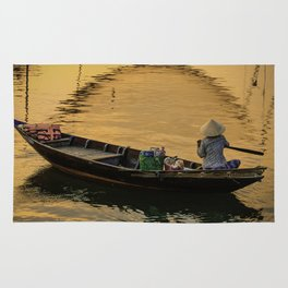 Boat on the River at Sunset Rug
