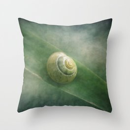 Shell in a sea of green Throw Pillow