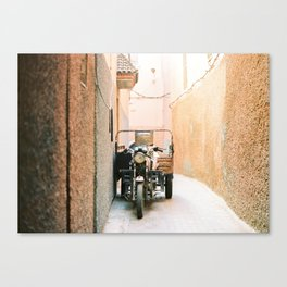 Vintage retro scooter / moped in the streets of magical Marrakech Canvas Print