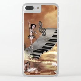 Cute girl dancing on a piano on the beach Clear iPhone Case