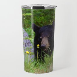 Black bear munches on some dandelions in Jasper National Park Travel Mug