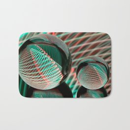 Green and red in two crystal balls. Bath Mat