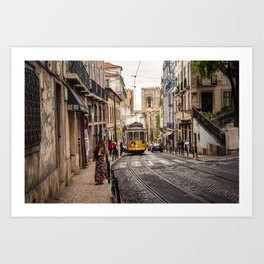 Tram 28 transports tourists through Alfama district in Lisbon, Portugal Art Print