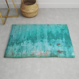 Weathered turquoise concrete wall texture Rug