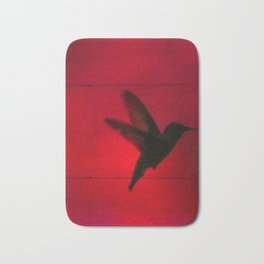 Hummingbird Behind the Red Blinds by CheyAnne Sexton Bath Mat