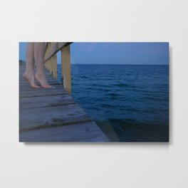 Woman standing on the edge of a pier Metal Print