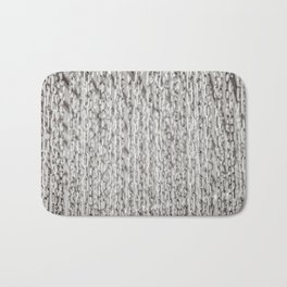 A Veil Of Hanging Metal Chains In Black And White Bath Mat