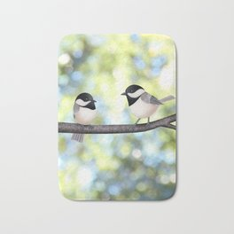 2 black-capped chickadees - bokeh Bath Mat