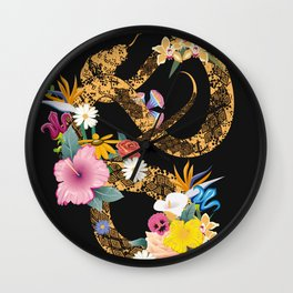 golden snake with flowers on black background Wall Clock