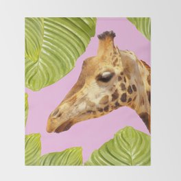 Giraffe with green leaves on a pink background Throw Blanket