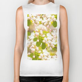 Apple tree branches with lovely flowers and buds on a pastel green background Biker Tank