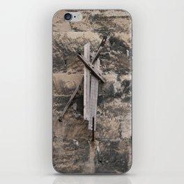 Drift wood on the stone wall iPhone Skin