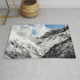 Snowy Mountains with Dramatic Clouds Rug