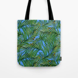 Palm leaves against the sky Tote Bag