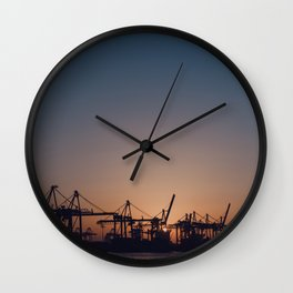 Sunset over Harbor Cranes in Hamburg Wall Clock