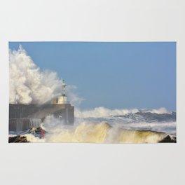 Stormy wave over lighthouse and pier of San Esteban de Pravia Rug