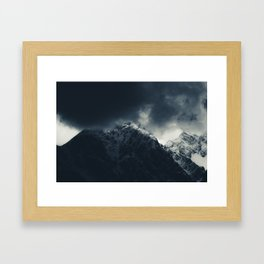 Darkness and storm clouds over mountains Framed Art Print