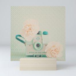 peach flowers & a mint green camera photograph Mini Art Print