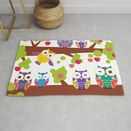 bright colorful owls on the branch of a tree with red apples Rug